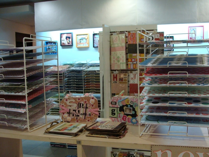 Shelves full of scrapbooking supplies in a store.