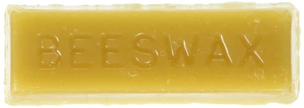 "Image of a bar of beeswax with the word ""beeswax"" embossed across it"