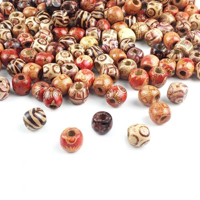 An assortment of wooden beads featuring different shapes, sizes, colors, and designs.