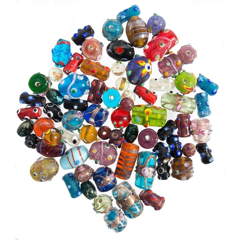 Assortment of of lampwork beads in many different colors, shapes, and sizes.