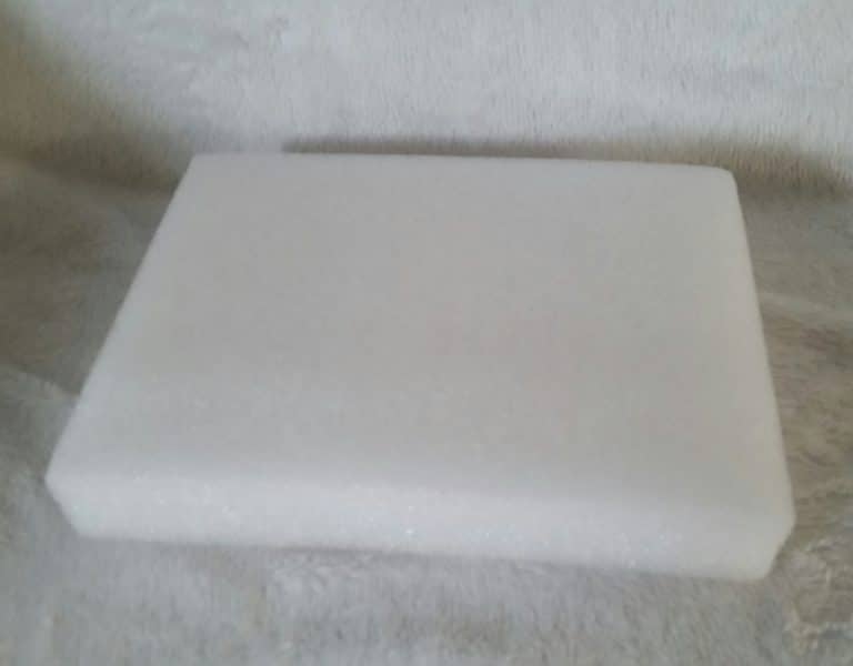 A white block of foam for creating wool crafts