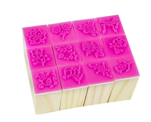 A set of 12 rubber floral stamps for ink stamping.