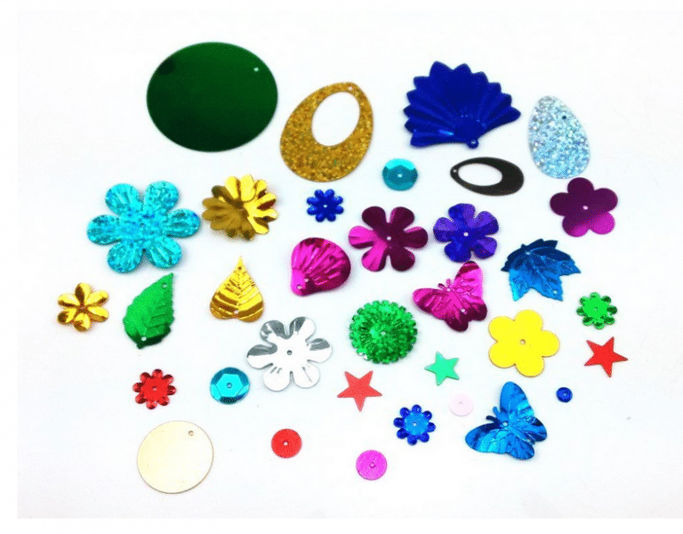 Sequins and charms to be used for ink stamping.