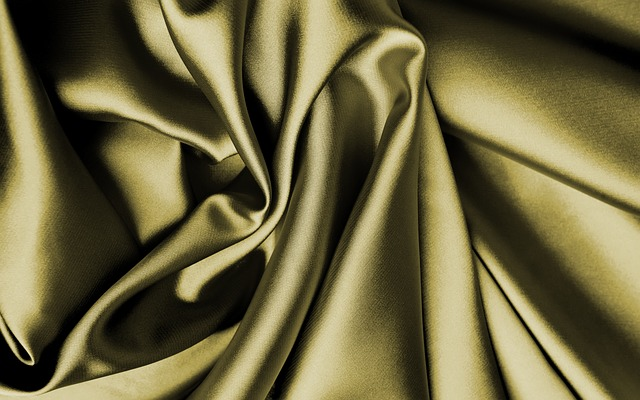 green silk fabric bunched up. Know your fabrics by touching materials like silk