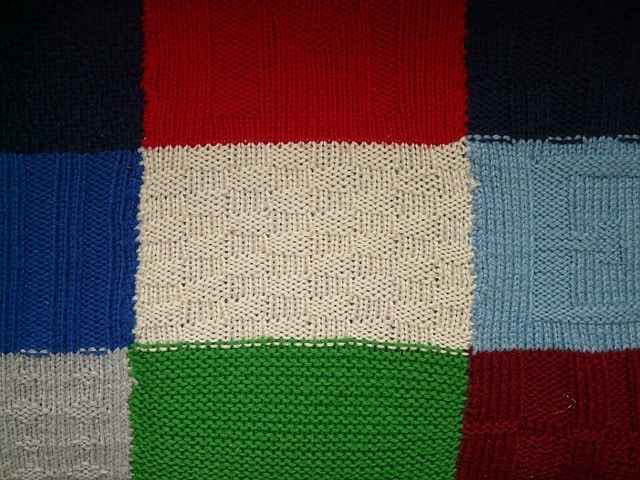 knit fabric with different colored squares.
