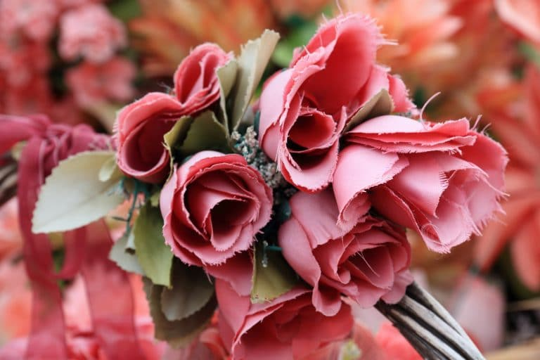 Pink fake flowers with frayed edges, an important risk to consider when choosing the best florals