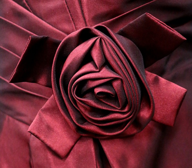 Know your fabrics well enough to make maroon satin roses like the one in this photo.