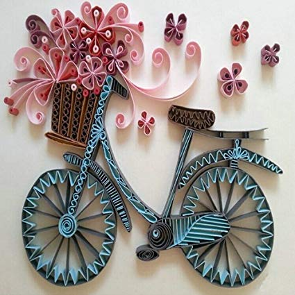 bicycle loaded with a basket full of flowers that is made from papers