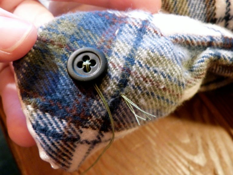 securing stitch on how to sew a button