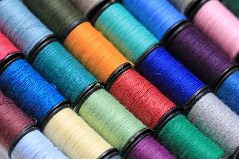 colored threads on how to sew a button
