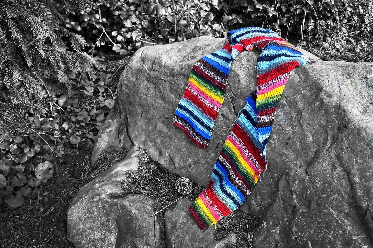 Colorful scarf on rocks