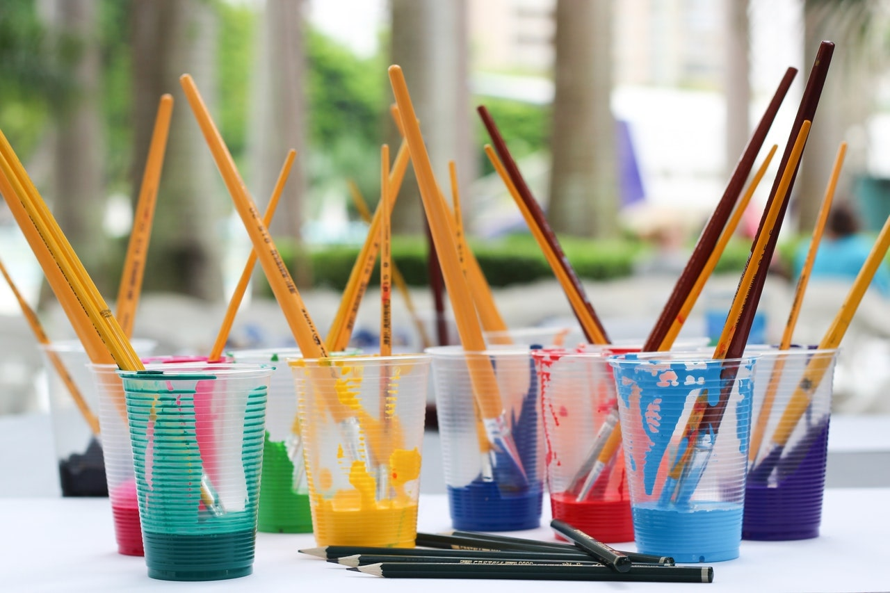 Paint brushes on plastic cups